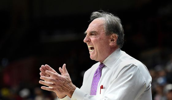 FILE - In this Feb. 28, 2018, file photo, Temple head coach Fran Dunphy yells instructions to his team in the second half of an NCAA college basketball game against Connecticut in Storrs, Conn. Dunphy will coach Temple for one more season before stepping down for assistant Aaron McKie to take over in 2019. Dunphy took over for retired Hall of Fame coach John Chaney in 2006 and has led the Owls to seven NCAA Tournaments. The Owls, who play in the American Athletic Conference, missed the postseason last season and were bounced in the first round of the NIT this year. (AP Photo/Stephen Dunn, File)