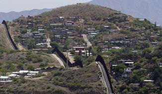 The International border cuts through Nogales, Sonora, Mexico, right, and Nogales, Ariz., as seen Tuesday, April 10, 2018 from Nogales, Ariz. The Republican governors of Texas, Arizona and New Mexico on Monday committed 1,600 Guard members to the border, giving President Donald Trump many of the troops he requested to fight what he's called a crisis of migrant crossings and crime. (AP Photo/Matt York)