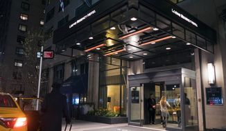 The Loews Regency Hotel is seen in New York, Monday, April 9, 2018. Federal agents raided the office of U.S. President Donald Trump's personal attorney Michael Cohen, seizing records on topics including a $130,000 payment made to porn actress Stormy Daniels. Besides Cohen's office, agents also searched a hotel room at the Loews Regency where he's been staying while his home is under renovation. (AP Photo/Craig Ruttle)
