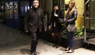 Michael Cohen, U.S. President Donald Trump's personal attorney, walks to his hotel, Tuesday, April 10, 2018, in New York. FBI agents on Monday raided Cohen's home, hotel room and office, seizing records on topics including a $130,000 payment made to porn actress Stormy Daniels in exchange for her silence about an affair she said she had with Trump in 2006. (AP Photo/Frank Franklin II)