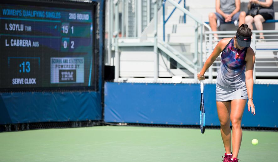 FILE - In this Aug. 24, 2017, file photo, Ipek Soyluas, of Turkey, prepares to serve as the serve clock ticks down during a U.S. Open tennis qualifying match in New York. The U.S. Open will have 25-second serve clocks on all of its courts during main draw matches this year to enforce time limits between points. The Grand Slam tournament, which begins in New York on Aug. 27,  will also have a strict 7-minute period from when players enter a court until action starts after the warmup.. (AP Photo/Michael Noble Jr., File)