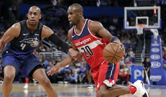 Washington Wizards' Jodie Meeks (20) drives around Orlando Magic's Arron Afflalo (4) during the first half of an NBA basketball game Wednesday, April 11, 2018, in Orlando, Fla. (AP Photo/John Raoux)