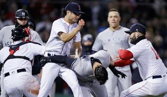 Boston Red Sox relief pitcher Joe Kelly, left, throws a punch at New York Yankees' Tyler Austin, center, as they fight during the seventh inning of a baseball game at Fenway Park in Boston, Wednesday, April 11, 2018. At right is Boston Red Sox first baseman Mitch Moreland. (AP Photo/Charles Krupa)