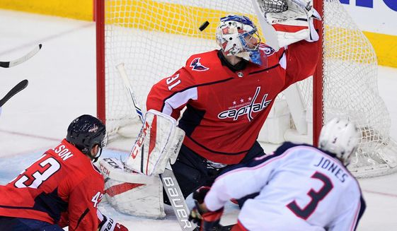 Blue Jackets defenseman Seth Jones scores a goal past Capitals goaltender Philipp Grubauer in the third period of Game 1 on Thursday. The Blue Jackets won, 4-3. (ASSOCIATED PRESS) ** FILE **