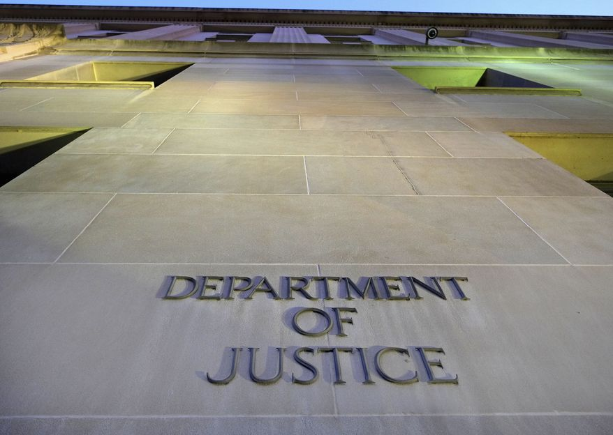 The Department of Justice headquarters building in Washington is photographed early in the morning on May 14, 2013. (Associated Press) **FILE**