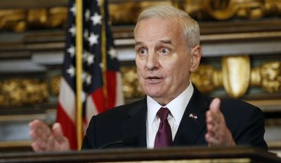 Minnesota Gov. Mark Dayton addresses the media where he discussed pending bills as the 2017 Legislature continues its duties at the State Capitol Friday, April 7, 2017, in St. Paul, Minn. (AP Photo/Jim Mone)