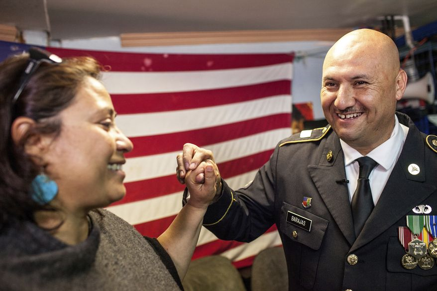 Hector Barajas, a U.S. Army veteran deported twice to Mexico, celebrated last month with Norma Chavez-Peterson, executive director of the American Civil Liberties Union of San Diego and Imperial counties, after learning that he would be granted American citizenship. (Associated Press)