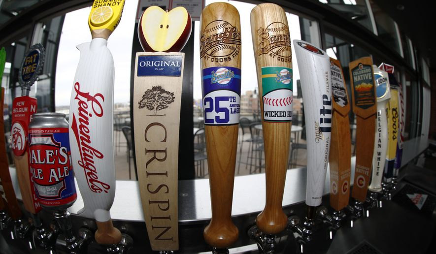 As viewed through a fisheye lens, beer taps line the rooftop bar in right field in Coors Field as preparations continue for the Colorado Rockies' regular-season home opener Thursday, April 5, 2018, in Denver. (AP Photo/David Zalubowski)