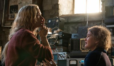 """This image released by Paramount Pictures shows Emily Blunt, left, and Millicent Simmonds in a scene from """"A Quiet Place."""" (Jonny Cournoyer/Paramount Pictures via AP)"""