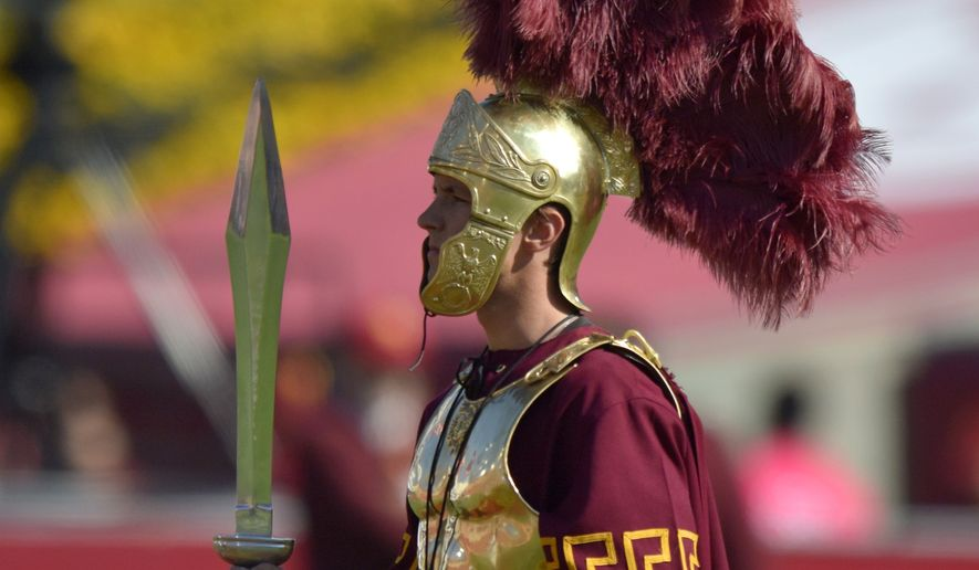 Southern California mascot Tommy Trojan performs prior to an NCAA college football game against Colorado, Saturday, Oct. 18, 2014, in Los Angeles. (AP Photo/Mark J. Terrill)