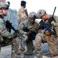 Members of Easy Company, 2nd Battalion, 506th Infantry Regiment, 4th Brigade Combat Team, 101st Airborne Division (Air Assault), pull security during a partnered patrol in Madi Khel, Khowst Province, Afghanistan, Oct. 20, 2013. (U.S. Army photo) ** FILE **