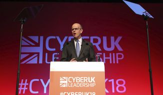 Jeremy Fleming, the director general of GCHQ addresses the Cyber UK conference hosted by the National Cyber Security Centre at the Manchester Central Convention Complex, Thursday April 12, 2018. (Owen Humphreys/PA via AP)