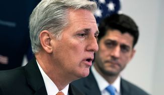 In this Feb. 6, 2018, file photo, House Majority Leader Kevin McCarthy, R-Calif., joined at right by Speaker of the House Paul Ryan, R-Wis., talks with reporters at the Capitol in Washington. (AP Photo/J. Scott Applewhite, File)
