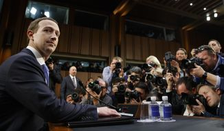 Facebook CEO Mark Zuckerberg takes a seat as he arrives to testify before a joint hearing of the Commerce and Judiciary Committees on Capitol Hill in Washington, Tuesday, April 10, 2018, about the use of Facebook data to target American voters in the 2016 election. (AP Photo/Carolyn Kaster)