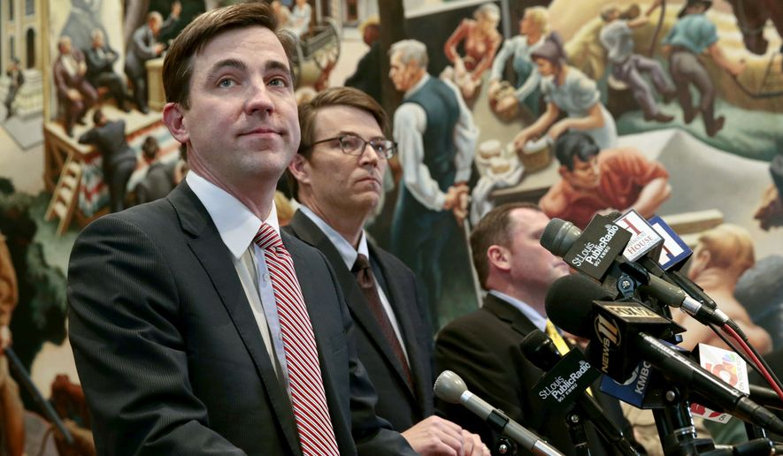 In this Feb. 26, 2018, photo, Missouri state Rep. Jay Barnes, left, speaks alongside House Speaker Todd Richardson at a press conference where it was announced that a committee has been formed to investigate the indictment of Gov. Eric Greitens stemming from a 2015 extramarital affair before he became governor. Barnes is head of the committee leading the investigation. (Robert Cohen/St. Louis Post-Dispatch via AP)/St. Louis Post-Dispatch via AP)