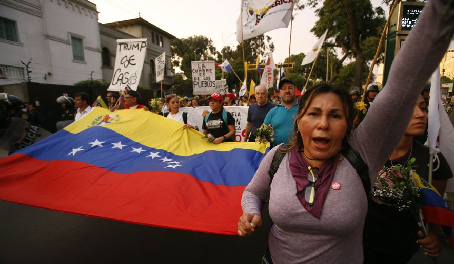 Venezuelans shout anti-Trump slogans during a protest against the Summit of the Americas, in Lima, Peru, Thursday, April 12, 2018. U.S. President Donald Trump had planned to attend the 8th Summit of the Americas in Lima canceled his plans, choosing to stay in Washington to manage the U.S. response to an apparent chemical weapons attack on civilians in Syria. (AP Photo/Karel Navarro)