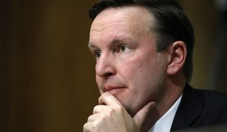 Sen. Chris Murphy, D-Conn., listens to testimony from Secretary of State-designate Mike Pompeo during a Senate Foreign Relations Committee confirmation hearing on Pompeo's nomination Thursday, April 12, 2018, on Capitol Hill in Washington. (AP Photo/Jacquelyn Martin)
