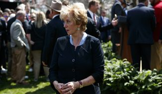 Small Business Administration administrator Linda McMahon leaves an event in the Rose Garden of the White House where President Donald Trump spoke about tax policy, Thursday, April 12, 2018, in Washington. (AP Photo/Evan Vucci)