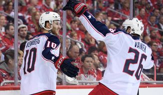 Columbus Blue Jackets center Alexander Wennberg (10) celebrates his goal with left wing Thomas Vanek (26) during the second period in Game 1 of an NHL first-round hockey playoff series against the Washington Capitals, Thursday, April 12, 2018, in Washington. (AP Photo/Nick Wass)