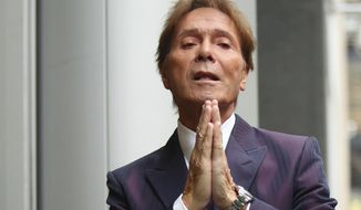 British singer Cliff Richard arrives at the Rolls Building in London, where a High Court judge is preparing to analyse evidence in a legal battle between singer Cliff Richard and the BBC, Thursday April 12, 2018.  The 77-year old singer Richard denies any wrongdoing and was never charged with any offence, and is suing the BBC over coverage of a police raid at his apartment in Sunningdale, England, in August 2014. (Yui Mok/PA via AP)
