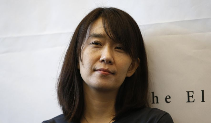 """FILE - In this Tuesday, May 24, 2016 file photo, South Korean author Han Kang poses for the media during a news conference in Seoul, South Korea.  The list of finalists for the prestigious Man Booker International Prize for fiction, announced Thursday, April 12, 2018 includes Iraqi writer Ahmed Saadawi's """"Frankenstein in Baghdad,"""" which depicts real and imaginary horrors after the U.S.-led invasion of Iraq. South Korea's Han Kang, who won in 2016 for """"The Vegetarian,"""" is nominated again for her meditative novel """"The White Book."""" Novels from France, Spain, Hungary and Poland are also on the list. (AP Photo/Lee Jin-man, file)"""