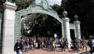 FILE - In this Aug. 15, 2017 file photo, students walk on the University of California, Berkeley campus in Berkeley, Calif. California community college students will be guaranteed admission into the University of California if they meet certain course requirements. University of California and the California Community Colleges agreed Wednesday, April 11, 2018, that students who do well in courses that UC faculty helped develop will win admission into a UC campus. (AP Photo/Marcio Jose Sanchez, File)