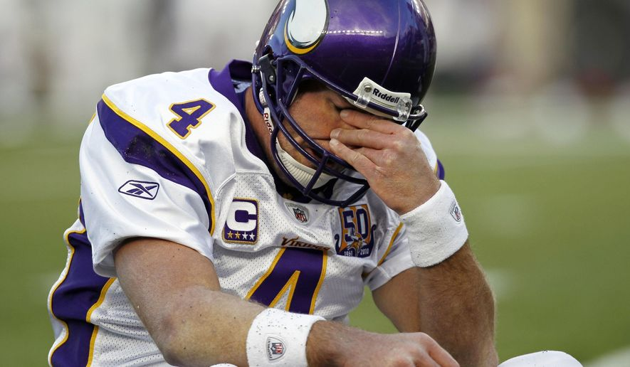 """FILE - In this Oct. 31, 2010, file photo, Minnesota Vikings quarterback Brett Favre rubs his eyes after being hit by New England Patriots linebacker Gary Guyton during the first quarter of an NFL football game in Foxborough, Mass.  Favre says he might have had """"thousands"""" of concussions during his Hall of Fame career. The three-time NFL MVP who played from 1992-2010 and was known for his aggressive approach to football said Thursday, April 12 2018 on NBC's """"Megyn Kelly Today"""" that he is experiencing short-term memory issues. (AP Photo/Winslow Townson, File)"""