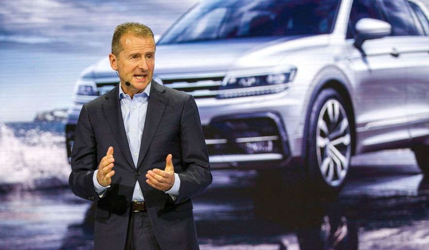 FILE - In this Jan. 15, 2018 Volkswagen brand Chairman Herbert Diess speaks at the North American International Auto Show in Detroit. The supervisory board of the German car maker is convening Thursday, April 12, 2018 to discuss a new leadership structure. (AP Photo/Tony Ding, file)