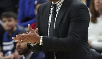 Memphis Grizzlies' head coach J.B. Bickerstaff directs his players in the second half of an NBA basketball game against the Minnesota Timberwolves, Monday, April 9, 2018, in Minneapolis. (AP Photo/Jim Mone)