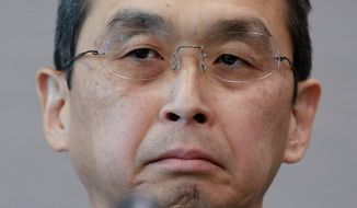 FILE - In this June 26, 2017 file photo, Japanese air bag maker Takata Corp. CEO Shigehisa Takada listens to a reporter's question during a press conference in Tokyo. Takata Corp., the Japanese air bag maker embroiled in a massive recall, says the acquisition by U.S. mobility safety company Key Safety Systems has been completed, and the president resigned.  Takata President Takada said Thursday, April 12, 2018,  in a statement he has resigned as president and chairman, replaced by Yoichiro Nomura, chief financial officer, effective Wednesday.(AP Photo/Shizuo Kambayashi, File)