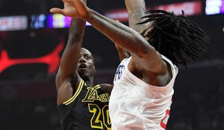 Los Angeles Lakers guard Andre Ingram, left, shoots as Los Angeles Clippers center DeAndre Jordan defends during the first half of an NBA basketball game Wednesday, April 11, 2018, in Los Angeles. (AP Photo/Mark J. Terrill)