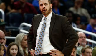 FILE - In this Dec. 15, 2017, file photo, Orlando Magic head coach Frank Vogel waits for an officials explanation on a foul during the second half of an NBA basketball game against the Portland Trail Blazers in Orlando, Fla. The Orlando Magic have fired Frank Vogel after two seasons. The Magic went 25-57 this season, finishing 54-110 under Vogel. The firing was announced Thursday morning, April 12, 2018, the day after the NBA season ended.  (AP Photo/Reinhold Matay, File)