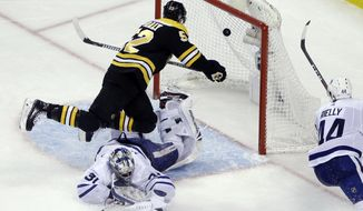 Boston Bruins center Sean Kuraly (52) scores against Toronto Maple Leafs goaltender Frederik Andersen (31) during the third period of Game 1 of an NHL hockey first-round playoff series Thursday, April 12, 2018, in Boston. (AP Photo/Elise Amendola)