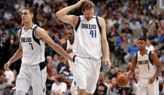 FILE - In this March 30, 2018, file photo, Dallas Mavericks' Dwight Powell (7), Dirk Nowitzki of Germany and Dennis Smith Jr., advance up court against the Minnesota Timberwolves in the first half of NBA basketball game in Dallas. Dallas missed the playoffs for the second straight year with its worst record since 1997-98, the season before Nowitzki was drafted. (AP Photo/Tony Gutierrez, File)