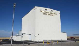 FILE - This Tuesday, Nov. 14, 2017, file photo, provided by the Idaho National Laboratory shows the Idaho National Laboratory Transient Reactor Test Facility in Idaho Falls, Idaho. Federal officials say there are no injuries at the nuclear facility in eastern Idaho following the release of radioactive material from a ruptured 55-gallon (208-liter) barrel inside a containment structure. The U.S. Department of Energy in a statement Thursday, April 12, 2018, says the breach occurred late Wednesday at the 890-square-mile (2,305-square-kilometer) site that includes the Idaho National Laboratory. (Chris Morgan/Idaho National Laboratory via AP, file)