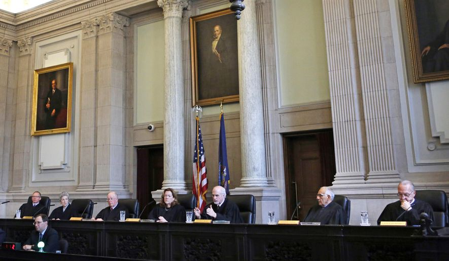 Justice Andrew M. Mead, third from right, ask a question during a hearing in the Maine Supreme Judicial Court on whether ranked-choice voting can be used in Maine's June 12th primary, Thursday, April 12, 2018, in Portland, Maine. (AP Photo/Robert F. Bukaty)