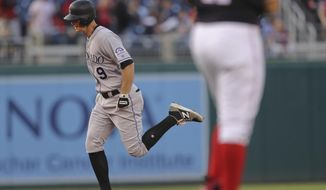 Colorado Rockies' DJ LeMahieu (9) circles the bases after hitting a solo home run off Washington Nationals starting pitcher Gio Gonzalez, foreground, during the first inning of a baseball game at Nationals Park, Thursday, April 12, 2018, in Washington. (AP Photo/Pablo Martinez Monsivais)
