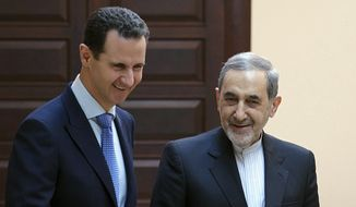 Syrian President Bashar Assad met Thursday in Damascus with Ali Akbar Velayati, an adviser to Iran's supreme leader, Ayatollah Ali Khamenei. (Associated Press)