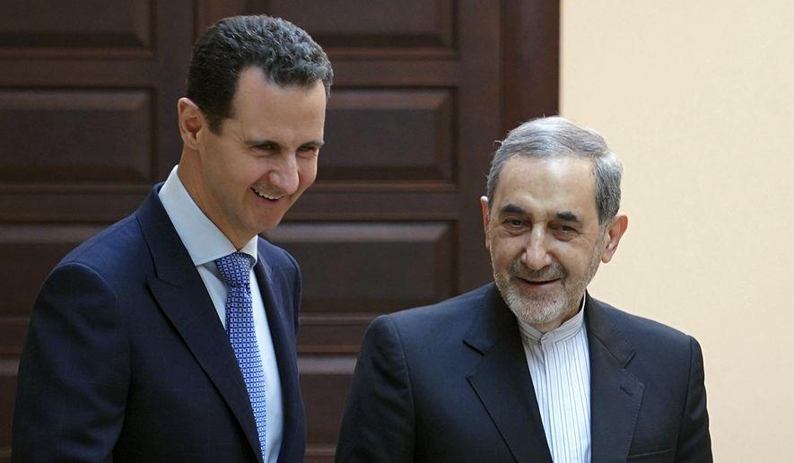 Syrian President Bashar Assad met Thursday in Damascus with Ali Akbar Velayati, an adviser to Iran's supreme leader, Ayatollah Ali Khamenei. (Associated Press)
