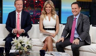 """FILE - In this Jan. 17, 2018 file photo, """"Fox & Friends"""" co-hosts, from left, Steve Doocy, Ainsley Earhardt and Brian Kilmeade appear on their set in New York. Roughly 1.5 million people watch """"Fox & Friends"""" each day, more than its counterparts at CNN and MSNBC and less than half the audiences for """"Good Morning America"""" or """"Today."""" (AP Photo/Richard Drew, File)"""