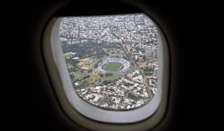 In this Friday, Jan. 26, 2018 photo, Centenario Stadium is seen from an airliner window as it flies over Montevideo, Uruguay. According to the Uruguayan sports minister the stadium is liable to be demolished or refurnished as part of their joint bid with Argentina and Paraguay for the 2030 soccer World Cup.  (AP Photo/Matilde Campodonico)