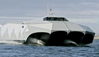 A few lucky onlookers were able to catch a glimpse of the Navy SEAL's M80 Stiletto, shown here in an image provided by the U.S. Navy, as it made its way along the Potomac River. The boat appeared at the annual Sea-Air-Space Exposition this year at Gaylord National Convention Center, National Harbor, Maryland, April 9-11. (Image: U.S. Navy) ** FILE **