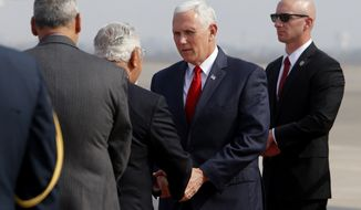 U.S. Vice President Mike Pence shakes hands with Peru's Housing Minister Javier Pique upon his arrival at the Jorge Chavez international airport in Lima, Peru, Friday, April 13, 2018. Pence is in Lima to attend the Americas Summit. (AP Photo/Karel Navarro)