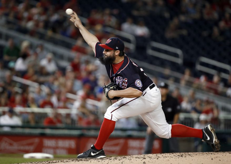 Washington Nationals starting pitcher Tanner Roark throws during the fourth inning of a baseball game against the Colorado Rockies at Nationals Park, Friday, April 13, 2018, in Washington. (AP Photo/Alex Brandon)