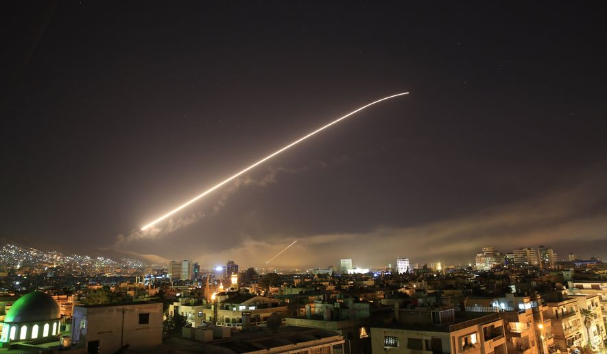 Damascus sky lights up with surface to air missile fire as the U.S. launches an attack on Syria targeting different parts of the Syrian capital Damascus, Syria, early Saturday, April 14, 2018. Syria's capital has been rocked by loud explosions that lit up the sky with heavy smoke as U.S. President Donald Trump announced airstrikes in retaliation for the country's alleged use of chemical weapons. (AP Photo/Hassan Ammar)