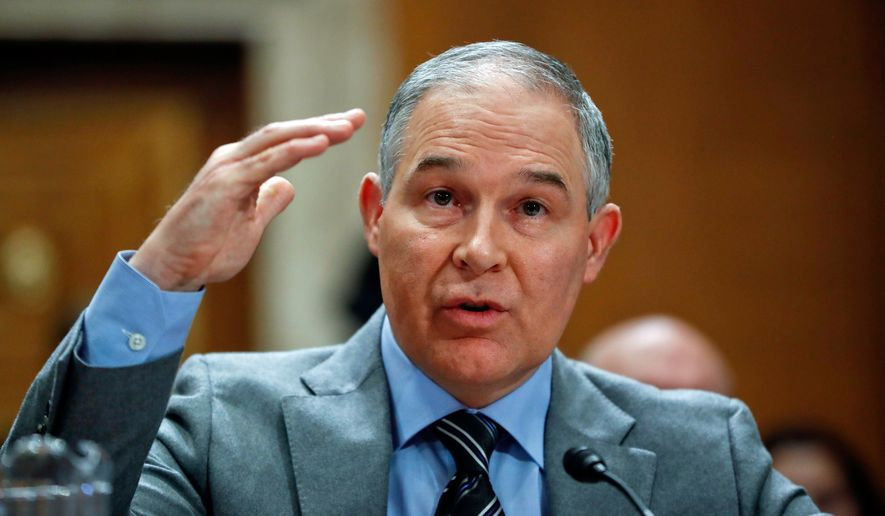 In this Jan. 30, 2018, file photo, Environmental Protection Agency Administrator Scott Pruitt testifies before the Senate Environment Committee on Capitol Hill in Washington. The Republican-led House oversight committee is demanding interviews with five close aides to embattled Pruitt, including his security chief. (AP Photo/Pablo Martinez Monsivais, File)