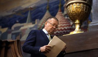 Russian Ambassador Alexander Yakovenko arrives for a press conference at his residence in London, Friday, April 13, 2018. (AP Photo/Kirsty Wigglesworth)