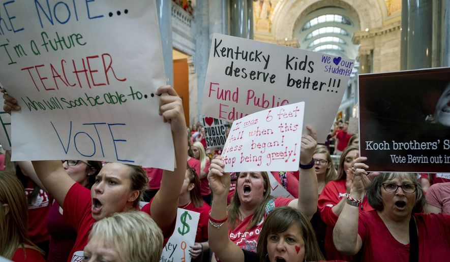 Teachers from across Kentucky gather inside the state Capitol to rally for increased funding for education, Friday, April 13, 2018, in Frankfort, Ky. (AP Photo/Bryan Woolston)