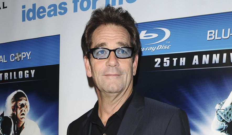 "FILE - In this Monday, Oct. 25, 2010 file photo, musician Huey Lewis attends the ""Back To The Future"" 25th anniversary reunion in New York. In a statement released Friday, April 13, 2018, Huey Lewis and The News announced the cancellation of its 2018 tour while frontman Lewis deals with the sudden loss of his hearing. (AP Photo/Peter Kramer)"