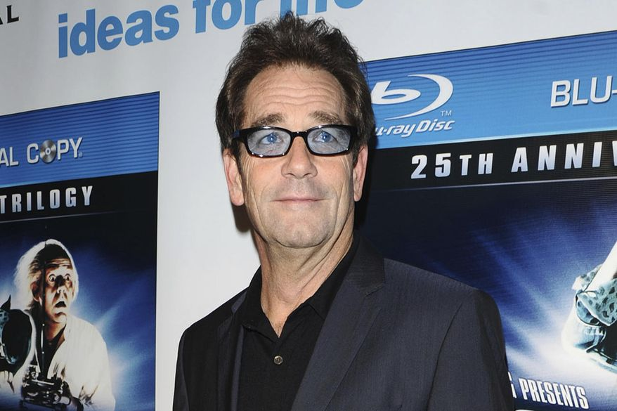 """In this Monday, Oct. 25, 2010 file photo, musician Huey Lewis attends the """"Back To The Future"""" 25th anniversary reunion in New York. (AP Photo/Peter Kramer)"""